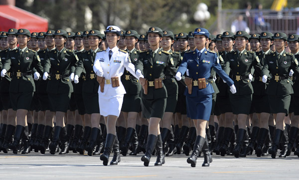 (091001) -- BEIJING, Oct. 1, 2009 (Xinhua) -- Female soldiers and officers of the three services of the Chinese People's Liberation Army march at the head of the march-past of a parade in the celebrations for the 60th anniversary of the founding of the People's Republic of China, in central Beijing, capital of China, Oct. 1, 2009. (Xinhua/Liu Dawei) (msq)